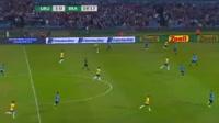 Jose Paulo Bezzera Maciel Junior scores in the match Uruguay vs Brazil
